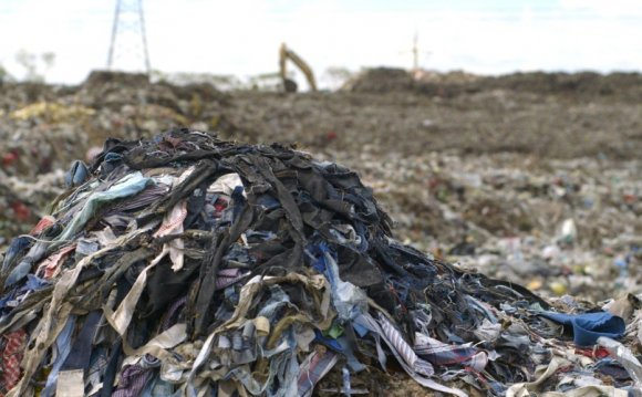 Clothing waste in a landfill