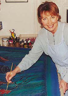 Jill Kennedy painting in her studio